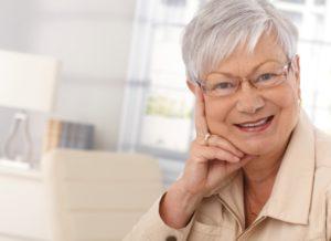 Woman smiling after Retina Surgery